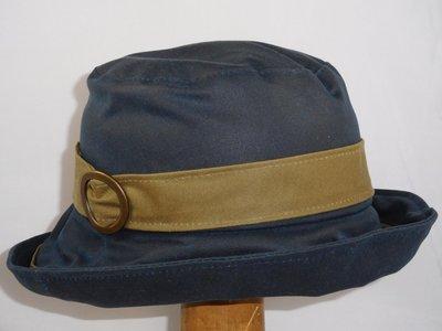 Bronte Wax / Regenhoed in donkerblauw en beige